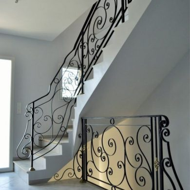 Hand rolled and curved railing